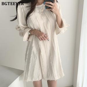 BGTEEVER Sonbahar Kış Basit Şık O-boyun Düğmeleri Katı Kadın Elbise Tam Kol Bölünmüş Püskül Manşet Yarık Kadınlar Elbise Günlük
