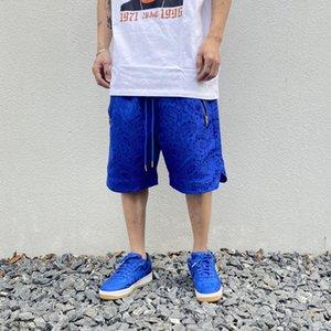 Fermeture à glissière poches Broderie hommes Shorts jambe large Streetwear Shorts Cargo à cordonnet Hip Hop Pant Longueur du genou