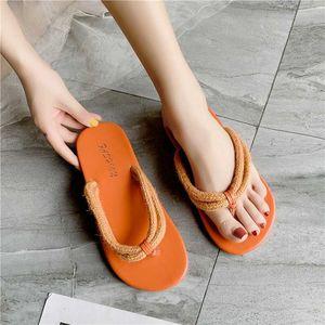 Веревка шлепки женские летние конфеты замороженные цвета тапочки носить прижимные пляж обувь крест ремни плоские тапочки женщин 2020