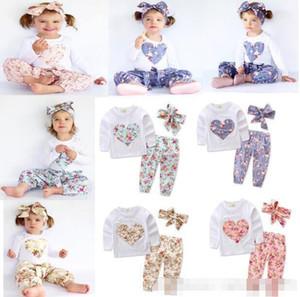 Neonata INS fiore a forma di cuore Tute Bambini Toddler Infant Casual T-shirt manica lunga corta + pantaloni + Fascia per capelli 3pcs set pigiami vestiti