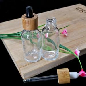 30 ml de cristal claro de la botella de aceite esencial cuentagotas cosmética pipeta del envase Botella Embalaje Eco Friendly Tapa de madera de bambú