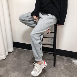 Designer NK brand casual breathable trousers men and women loose and comfortable guard pants trend thin section beam pants sports pants.