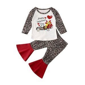 День Нового младенческого Kids Baby Girl одежду Валентина Leopard Печатается с длинным рукавом футболка + Flared Pant Outfit
