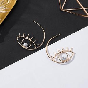 AOMU 2019 Nouveau Simple Exagérer Design Mignon Boucles d'oreilles en métal marbre yeux Cils Stud pour les femmes creux Bijoux Fashion Brincos cadeau