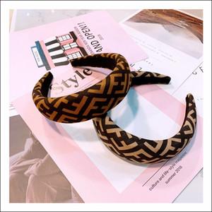 Amplia letras borde de leopardo de impresión sencilla banda de pelo todo-fósforo accesorios de tarjeta pelo antideslizante Corea del otoño y del invierno original de encargo nuevos estilos