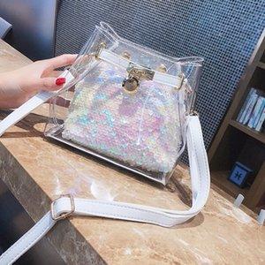 2020 مصمم أزياء المرأة حقائب مصمم السفر حقيبة الأمتعة واق من المطر حقيبة دوت الترتر وميض عصري المواد البلاستيكية حقيبة يد سيدة