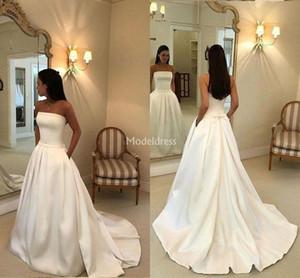Einfache schwarze Mädchen Brautkleider trägerlos eine Linie Sweep Zug Bow Pockets Garten Brautkleid Plus Size Kapelle Schloss Chic Vestidoe De Noiva