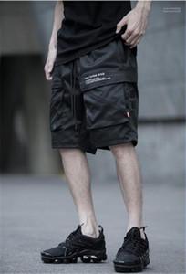 Pantalones cortos flojo longitud de la rodilla Pantalones de carga Deportes Adolescente forman los cortocircuitos con los bolsillos para hombre de los pantalones del verano masculino