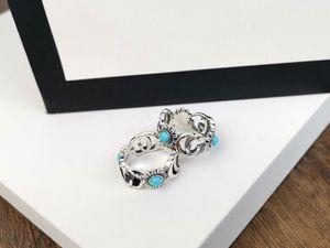 Europa Amerika Retro Style-Mann-Dame-Frauen Titan Stahl Silber plattiert gravierte Blumen G Brief Einstellungen Türkis Ringe Size6-9