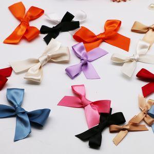 100pcs mezcla y combinación de seda del Bowknot 4 * 3cm fiesta de cumpleaños decoración de la boda de la invitación Tarjeta Grandes Eventos fuentes del arte Varios Bowknot