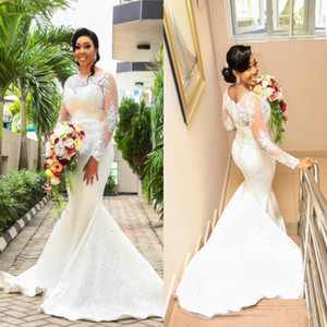 Luxury Vintage lace Mermaid Wedding Dresses 2018 Sheer Long Sleeve Jewel Appliques Beaded Sweep Train African Bridal Gowns Plus Size