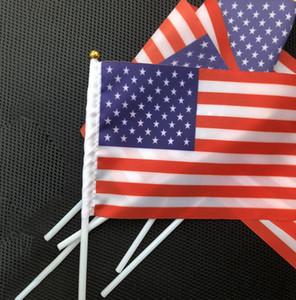 عقدت الولايات المتحدة الأمريكية العلم الأميركي اليد البسيطة العلم USA حزب مهرجان الأمريكية الولايات المتحدة الصغيرة اللوازم العلم 14 * 21CM LJJK2168
