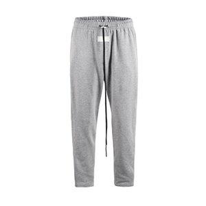 Hommes Pantalons Designer Side ouvert Bouton Streetwear Pantalon taille coulissée élastique Sweatpants Joggings Hommes