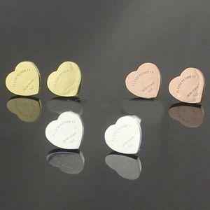 Marque de mode en acier inoxydable 316L coeur lettres boucles d'oreilles 10mm titane SteelQuality NEW YORK femmes amour boucles d'oreilles