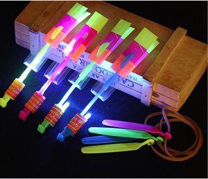 niños juguetes 100pcs * Caucho banda catapulta LED Flying Gyro las flechas helicóptero juguetes de los niños paraguas