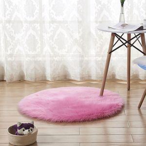 Yuvarlak halı yatak odası Için pembe siyah yumuşak tüylü peluş alan kilim çocuk odası Için kaymaz yapay koyun derisi sıcak paspaslar