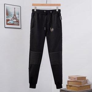 Hip-hop movimiento traje masculino Conjunto trajes de pista de Sweatsuit hombre del chándal impresos Phillip Llano de las bragas de la cremallera Outwear 2PC chaqueta + pantalones Conjuntos