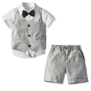 Jungenausstattungskindrevers Kurzarmhemd + einreihige Weste + Doppeltaschenkurzschlüsse 3pcs stellt Kinderleistungskleidung F7734 ein