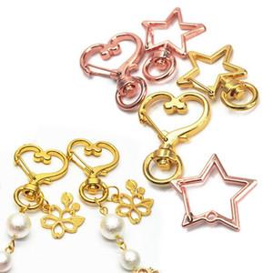 I risultati dei monili di alta qualità parte girevole del metallo catenaccio moschettone forma di stella di cuore fai da te Portachiavi auto Portachiavi Accessori