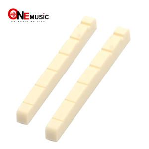 50pcs al por mayor de Marfil plástico R400 43x3.4x4.6-3.8MM guitarra eléctrica de tuerca de la guitarra eléctrica de la guitarra eléctrica de piezas de piezas de bricolaje
