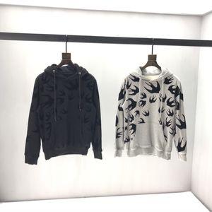 Mode-Männer Pullover lose große Damen Pullover Beflockung schlucken Muster mit Kapuze Pullover Jugend Student Pullover 2020 Herbst und Winter n