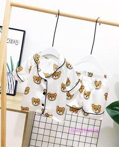 Meninos de manga curta Pijamas 2pcs Childrens Pijamas Pijamas Define Treino Roupa das Crianças Crianças Moda Designs Roupa