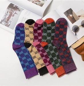 Moda autunno nuovo colore lettera caramelle mucchio mucchio tendenza calzini moda femminile multicolore calze di cotone selvatiche