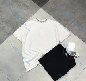 Acne Studios T-shirt Xshfbcl الصيف أزياء السيدات رجل جديد T-shirt قطن كبير عيون التطريز الترتر حب الشباب نمط تي شيرت النجمة