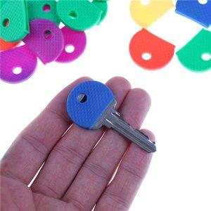 Polvo de puerta del botón Covers 10pcs / porción al azar Moda hueco de múltiples colores de goma suave cerraduras con llave llaves cubierta de la tecla Covers Topper llavero