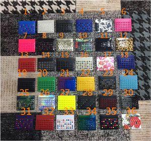 Nouveau porte-monnaie en cuir noir en Europe et en Amérique du rouge bord ongles tricolore bleu-violet ongles hommes sac perle de carte et les femmes paquet de cartes de visite