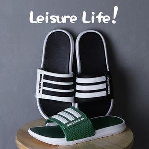 Zapatillas hombres del estilo de pareja y para mujer de versión juvenil de Corea y la tendencia de la moda las sandalias de interior distribución al por mayor