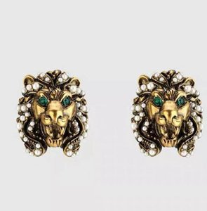 Frauen Neue europäische und amerikanische Barock Retro-Löwe-Kopf Ohrringe Persönlichkeit Kleine Perle Temperierte Metall Textur Ohrringe Frauen