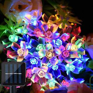 حار بيع LED سلسلة أضواء تعمل بالطاقة الشمسية 50LEDs 7M ساكورا سلسلة بقيادة الشمسية حديقة الخفيفة الجنية الملونة الخفيفة وسام عيد