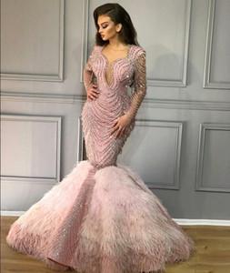 Vestido de noche Yousef aijasmi Kim kardashian Charble Elie saab Baby Pink Feather Mermaidl Perlas V = Cuello manga larga Zuhair murad 101