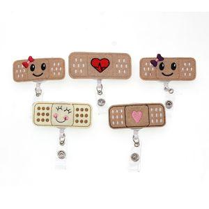 Di trasporto 10pcs / lot Medical RN Felt Bandage retrattile Nursing distintivo bobina