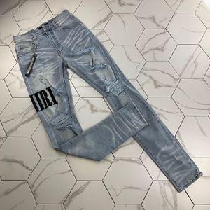 Ahora diseñador del Mens vaqueros desgastados cremallera Hole Hombres Vaqueros de alta calidad pantalones vaqueros ocasionales de los hombres del motorista flaco pantalones azules grandes Size30-38