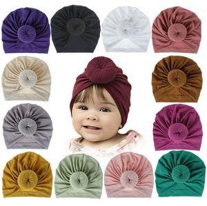 Zubehör Neugeborene Kleinkind-Kind-Baby-Jungen-Mädchen Turban Cotton Strickmütze Winter-warme weiche Cap Fest Knot weiche Verpackungs-18 Farbe