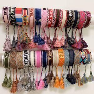 Pulseira tecida de tecido de corda de estilo de luxo com palavras de costura e borla alça de mão amarra jóias para as mulheres presente
