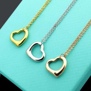 Neu kommen mode dame titanium stahl 18 karat überzogene gold halskette mit t brief aushöhlen einzelne herz anhänger