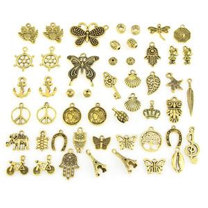 Diseños mixtos de oro retro del color clave del timón caparazón de tortuga Bird Torre de la mano de la mariposa búho bicicletas ... Hadas para la joyería DIY 50pcs de montaje / bolsa
