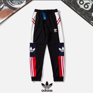 Pantalones deportivos de talla grande M-XXL para hombre nuevos pantalones deportivos con estampado de letras a rayas para hombres pantalones de chándal de algodón para hombres envío gratis