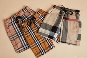 детские брюки 2019 INS горячие стили новые летние стили мальчики дети клетчатые брюки высокое качество хлопок повседневные стили шорты 3 цвета бесплатная доставка