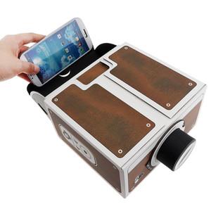 1pcs Projetor 3D DIY cartão Mini Smartphone projetores de luz Novidade ajustável Mobile Phone projetor portátil Cinema em uma caixa