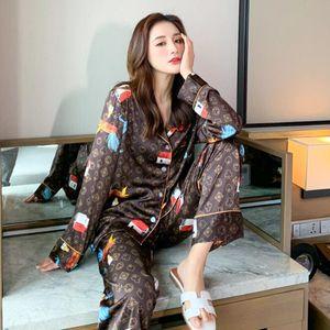 Sexy Eis-Silk Print Pyjamas Anzüge Paar Nachtwäsche-Sets Familie Pijama Liebhaber Thin Long Sleeves Nightgown Männer Frauen Lässige Heim Kleidung