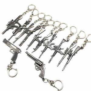 الجملة 50pcs / الكثير سلسلة لعبة بندقية نموذج مفتاح سبائك معادن مفتاح خواتم مفاتيح حاملي حجم 6cm وسلاسل حزمة البثرة بطاقة مفتاح
