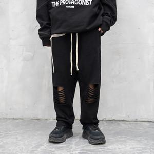 Sweatpants rasgadas pretas para homens Hip Hop furo de suspensão Crotch Pant Streetwear Vintage suor Casual Calças masculinas Baggy Trousers