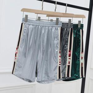 Летом новые случайные брюки пара мужские брюки импортированные сверху ледяной шелк Светоотражающие мягкие верхние полосы ткани буквы напечатаны шить пляжные шорты