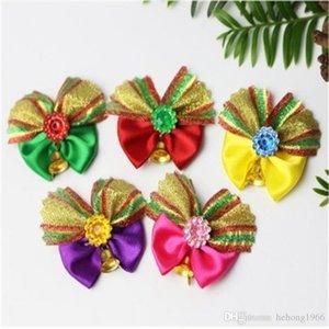 Flor Perro nueva creativo Merry Christmas Bow Pequeña Alarma corbatas Cabeza del perrito del caniche Adornos gato corbata preparación del animal doméstico Material 1 2AW