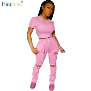 Haoyuan Zweiteiler Sommer-Outfits für Frauen Anzug Crop Top und Loch Stacked Hosen Trainingsanzüge Lounge Wear Matching Sets