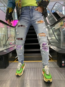 de la marque de marée européens et américains de nouveaux hommes de jeans pantalon à la mode coréenne Slim pantalon mode hole décoration fermeture à glissière point de patte main materi